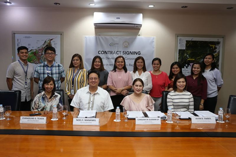 CLARK. CDC President and CEO Noel F. Manankil (1st row, 2nd from left), CDC VP for Business Development and Business Enhancement Group Evangeline G. Tejada (1st from left) DOT Regional Director Carolina Uy (2nd from right) and DOT Chief Tourism Operations Officer Avon D. Timbol (last from left) signed the lease agreement between CDC and DOT-Central Luzon for new location of its regional office inside Clark Freeport Zone. (PR)