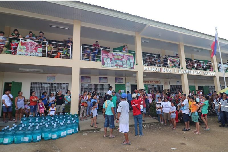 BACOLOD. Ayala Foundation partners and volunteers distribute nutritious meals, hygiene kits, water, and other relief items for the families displaced by the recent eruption of Taal volcano. (Contributed photo)