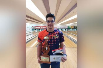 DAVAO. Gabriel Velasco, a 24-year-old graduating nursing student of Davao Doctors College, poses with his champion's trophy and cash prize after defending his title at the close of the Datba Bowler of the Year 2019 grand finals held Sunday, January 19, at SM Lanang Premier Bowling Center. (Contributed photo)