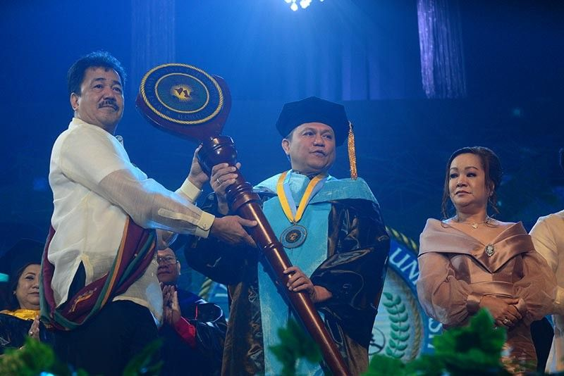 ILOILO. Dr. Prospero De Vera III, chairperson of Commission on Higher Education and WVSU Board of Regents imposed the Academic Medallion and presentation of Academic Mace to Dr. Joselito F. Villaruz, 8th president of West Visayas State University, Wednesday, January 22, 2020, at the West Visayas State University Cultural Center. (Leo Solinap)