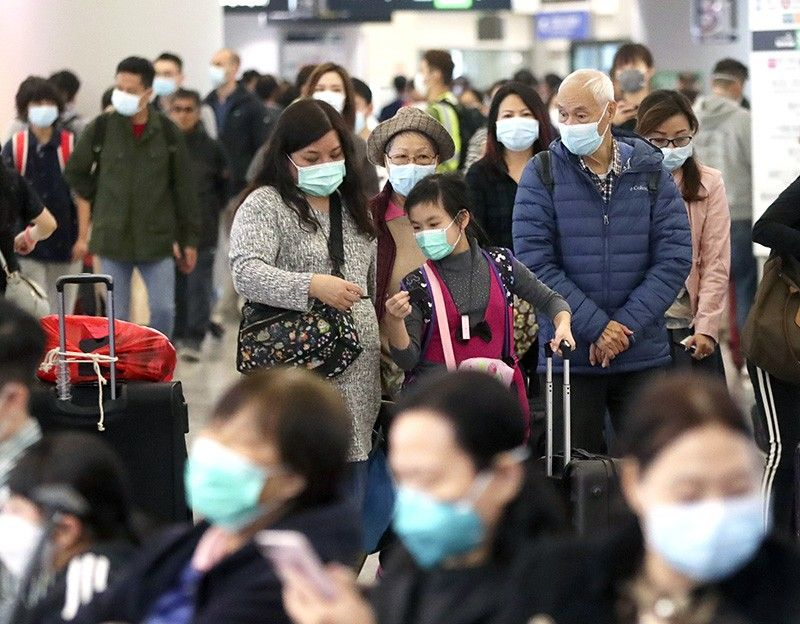 Passengers wearing protective face masks enter the departure hall of a high speed train station in Hong Kong, Friday, Jan. 24, 2020. China expanded its lockdown against the deadly new virus to an unprecedented 36 million people and rushed to build a prefabricated, 1,000-bed hospital for victims Friday as the outbreak cast a pall over Lunar New Year, the country's biggest, most festive holiday.<b>(AP)</b>