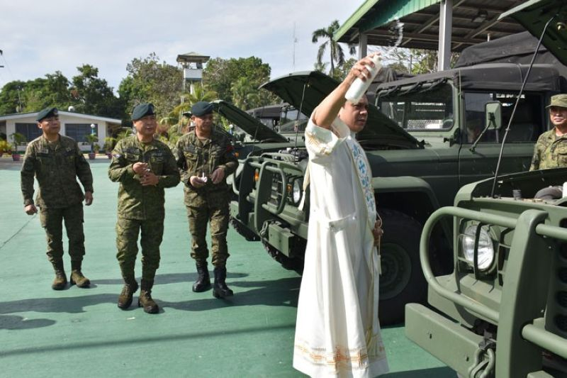ZAMBOANGA. Reverend Father Jeffrey Mirasol officiated the blessing of the five KM450 vehicles issued to the Western Mindanao Command (Westmincom) by the Armed Forces of the Philippines (AFP) General Headquarters. Looking on are Westmincom officials led by Lieutenant General Cirilito Sobejana, Westmincom chief (2nd from left at the back). (Contributed photo)