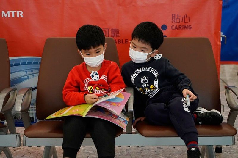 HONG KONG. Passengers wear masks to prevent an outbreak of a new coronavirus in the high speed train station, in Hong Kong, Wednesday, Jan. 22, 2020. The first case of coronavirus in Macao was confirmed on Wednesday, according to state broadcaster CCTV. The infected person, a 52-year-old woman, was a traveller from Wuhan. (AP)