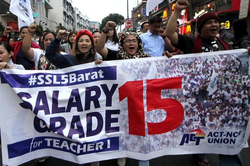 BAGUIO. Members of the Alliance of Concerned Teachers (ACT) Party-list, a political party representing teachers and education sector workers march down Session Road Friday evening, January 24, 2020 demanding to raise salary grade for teacher I to salary grade 15. (Photo by Jean Nicole Cortes)