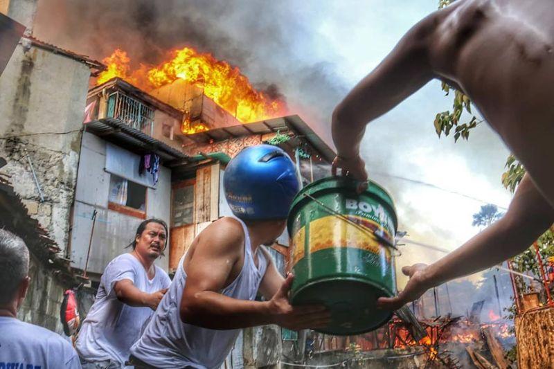 CEBU. A fire broke out at a residential area in Sitio Panagdait, Barangay Kasambagan, Cebu City Sunday, January 26, 2020. (Photo by Amper Campaña)
