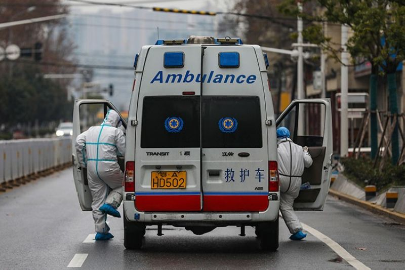 CHINA. In this Sunday, January . 26, 2020 photo, ambulance crew members in protective gear get into their ambulance in Wuhan in central China's Hubei Province. (AP)