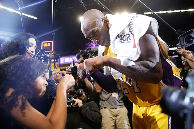 USA. In this April 13, 2016 file photo Los Angeles Lakers' Kobe Bryant (right) fist-bumps his daughter Gianna after the last NBA basketball game of his career, against the Utah Jazz in Los Angeles. (AP)