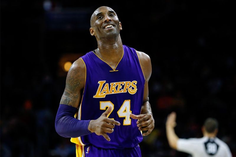 In this Dec. 1, 2015 file photo Los Angeles Lakers' Kobe Bryant smiles as he jogs to the bench during the first half of an NBA basketball game against the Philadelphia 76ers in Philadelphia. The Retired NBA superstar has died in helicopter crash in Southern California, Sunday, January 26, 2020. (AP)
