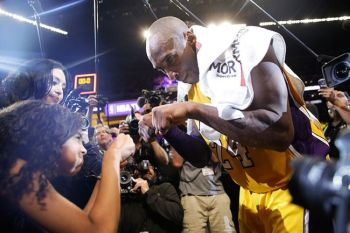 USA. In this April 13, 2016 file photo Los Angeles Lakers' Kobe Bryant (right) fist-bumps his daughter Gianna after the last NBA basketball game of his career, against the Utah Jazz in Los Angeles. (AP) onerror=