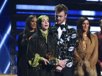SONG OF THE YEAR. Billie Eilish, left, and Finneas O'Connell accept the award for song of the year for