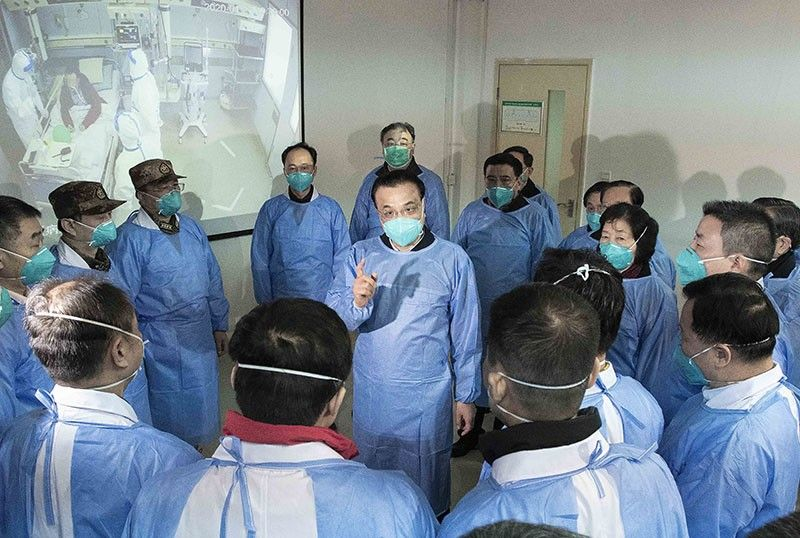 BEIJING. In this photo released by China's Xinhua News Agency, Chinese Premier Li Keqiang, center, speaks with medical workers at Wuhan Jinyintan Hospital in Wuhan in central China's Hubei province, Monday, January 27, 2020. China on Monday expanded its sweeping efforts to contain a deadly virus, extending the Lunar New Year holiday to keep the public at home and avoid spreading infection. (AP)