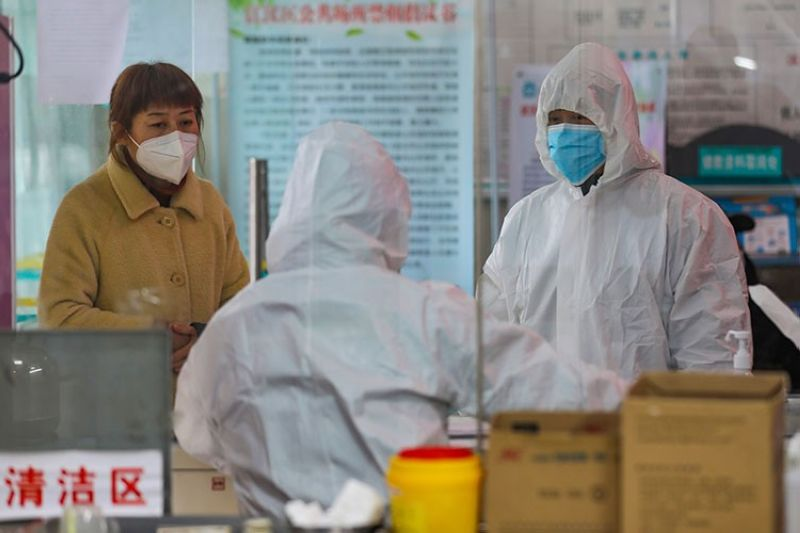 CHINA. Medical workers in protective gear talk with a woman suspected of being ill with a coronavirus at a community health station in Wuhan in central China's Hubei Province, Monday, January 27, 2020. (AP)