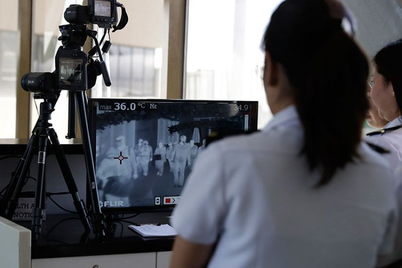 MANILA. Airport personnel look at thermal scanners as they check on arriving passengers at Manila's international airport Thursday, January 23, 2020. (AP)