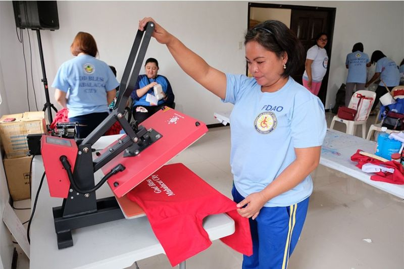 PAMPANGA. A person with disability learns t-shirt printing skills during the free skills training program conducted by the Mabalacat City Persons with Disabilities Affairs Office. (Contributed photo)