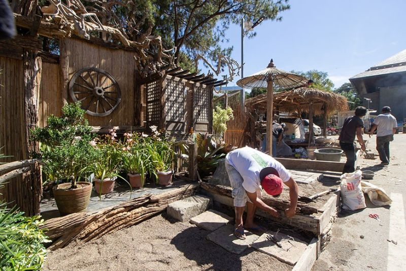 BAGUIO. Contestants in the landscape competition start to build their entry outside the Baguio Convention Center for the upcoming Panagbenga Festival slated this February 2020. (Photo by Jean Nicole Cortes)