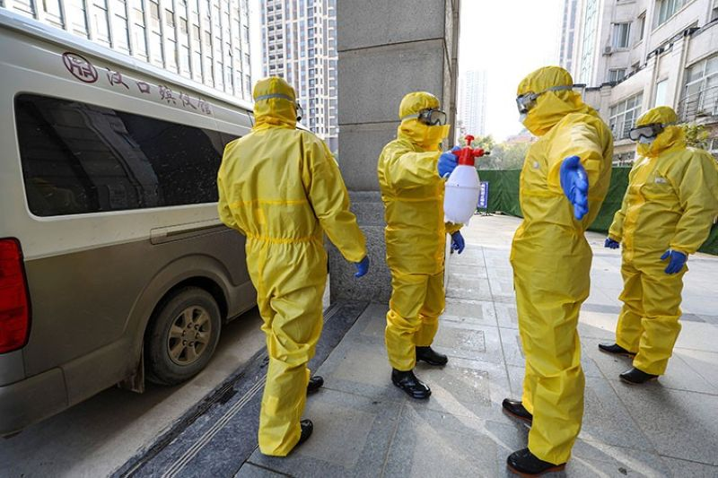 CHINA. Funeral workers disinfect themselves after handling a virus victim in Wuhan in central China's Hubei Province, Thursday, January 30, 2020. (AP)