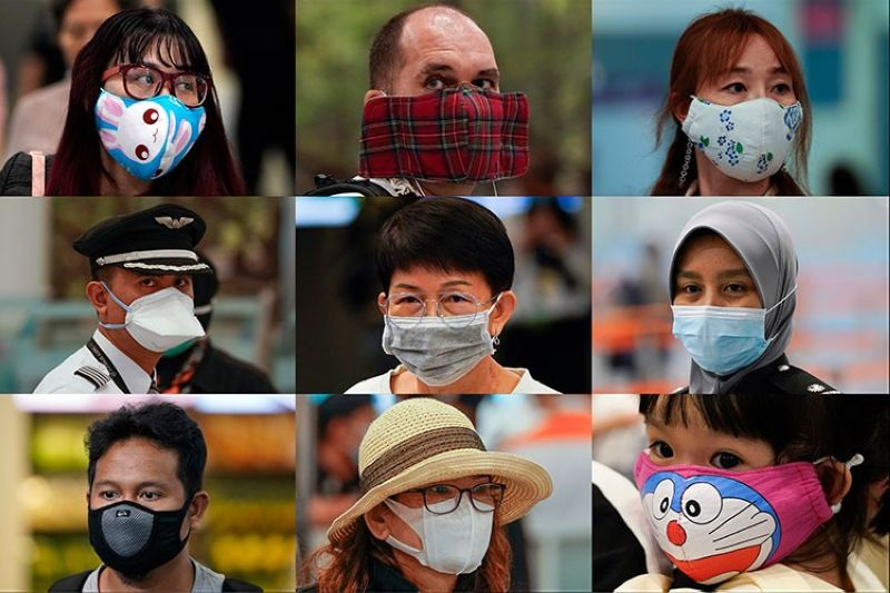 MALAYSIA. In this Wednesday, January 29, 2020, combination of photos, people wear various masks as they wait at an immigration counter at an airport terminal in Sepang, Malaysia, outside Kuala Lumpur. Face masks are in short supply in parts of the world as people try to stop the spread of a new virus from China. (AP)