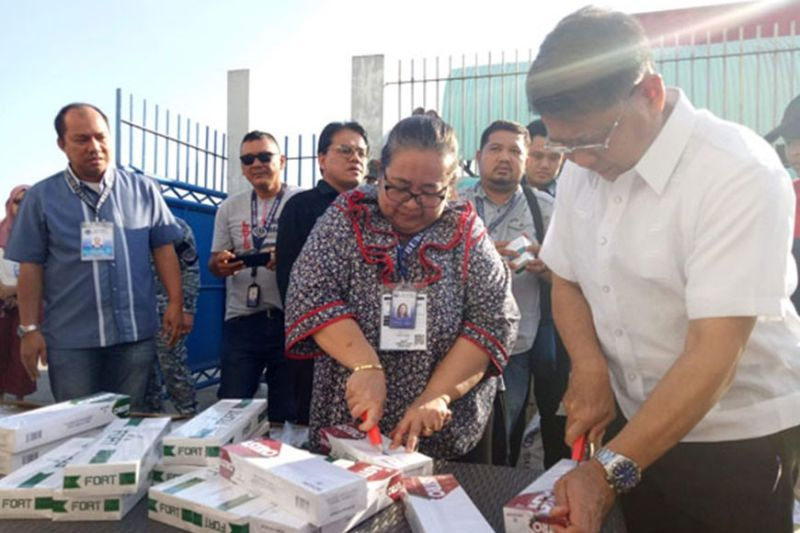 ZAMBOANGA. Bureau of Customs (BOC) Commissioner Leonardo Rey Guerrero (left) joins the BOC-Zamboanga officials in destroying the confiscated smuggled cigarettes the Marine and Coast Guard operatives seize Thursday, January 30, 2020, at the Zamboanga port. The seized contraband is worth over P2.6 million. (Contributed photo)