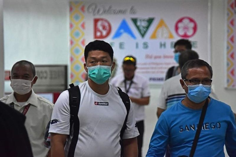 #SunStarLens MASKED UP. Passengers from Manila wait for their baggage at the carousel area inside Francisco Bangoy International Airport in Davao City yesterday. Almost all of the departing and arriving passengers at the airport are now wearing masks following the first confirmed 2019 novel coronavirus case in Manila on Thursday. (MACKY LIM)