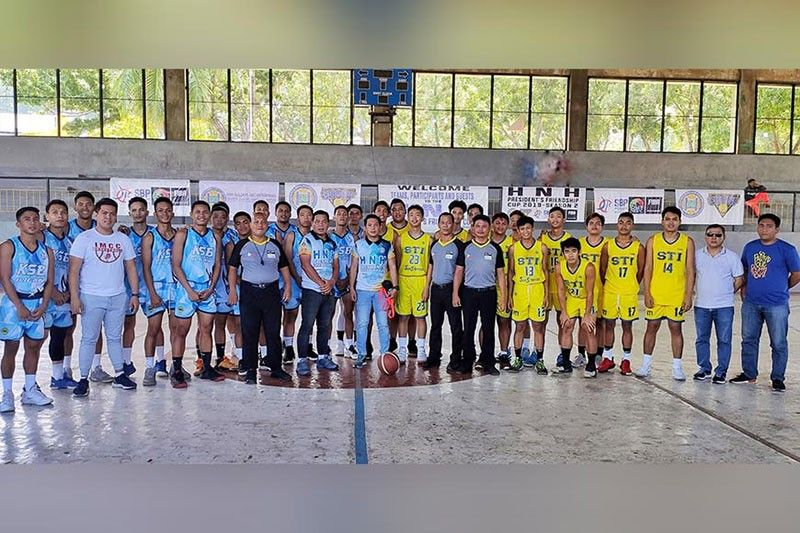 """CAGAYAN DE ORO. The STI Olympians of coach Edgardo """"Boy"""" Dacoco and team manager Mario Malferrari Jr. after a thrilling one-point victory, 96-95 over the Iligan Medical Center College (IMCC) of Iligan City during the HNH-PCCL qualifying tourney in Cagayan de Oro City. (Contributed Photo)"""