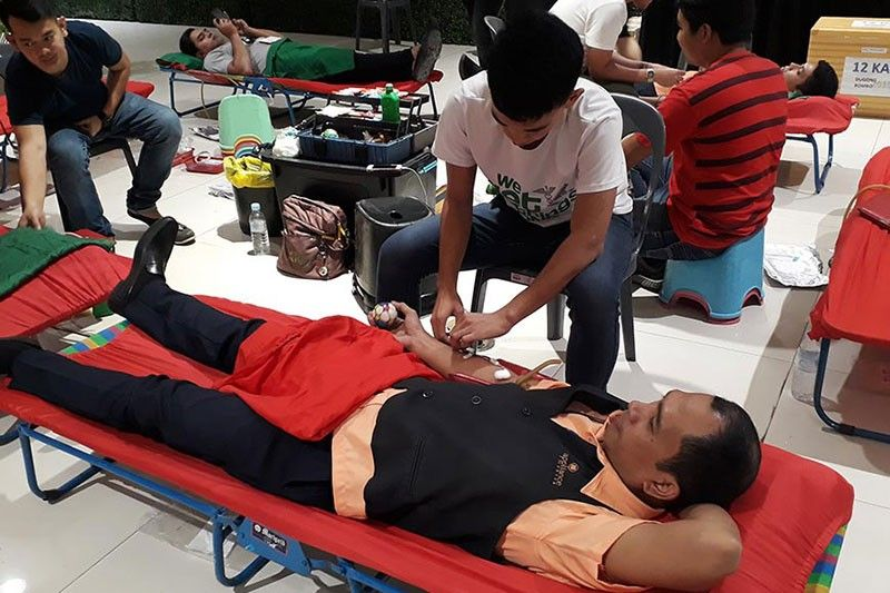 CAGAYAN DE ORO. Donors, mostly men, join the Blood Donation Drive conducted by the Philippine Red Cross at two SM malls in Cagayan de Oro City. (Photo by Jo Ann Sablad)