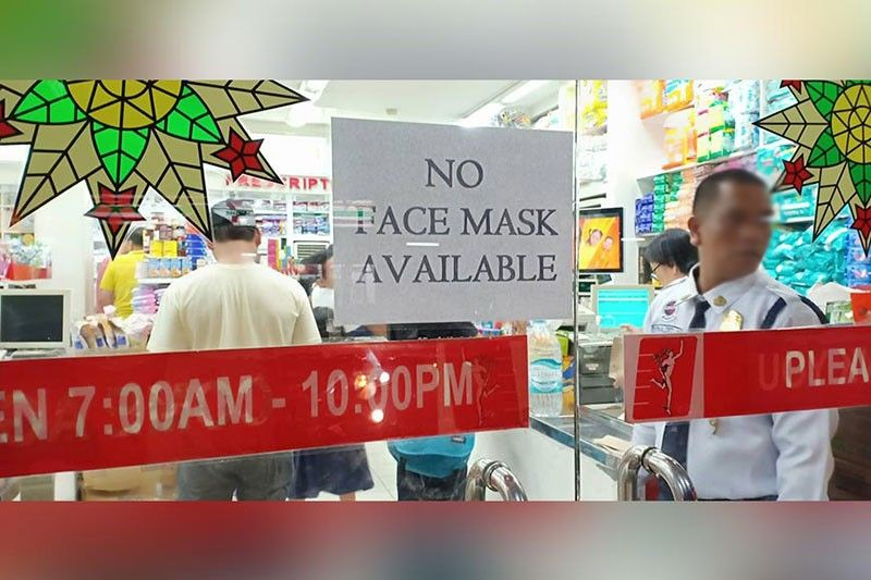 "CAGAYAN DE ORO. A ""No face mask available"" sign is placed on the glass door of a pharmacy. Residents are in quandary to secure protective face masks amid the widespread threat of 2019 novel coronavirus, thus resulting to shortage. (Photo by Lynde Salgados)"