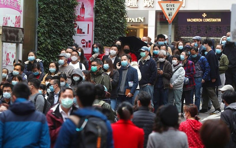 HONG KONG. People queue up to buy face masks in Hong Kong, Saturday, Feb, 1, 2020. China has moved to lock down at least three big cities in an unprecedented effort to contain the deadly new virus that has sickened hundreds of people and spread to other parts of the world. (AP Photo/Achmad Ibrahim)