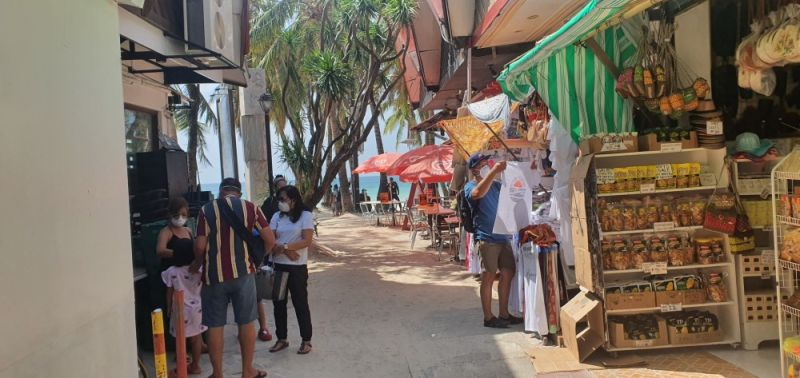 Several tourists visiting D'Mall in Boracay wear face masks as their personal protection against the 2019-nCoV ARD.
