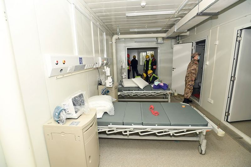 CHINA. A Chinese army medic looks at a patient room at the Huoshenshan temporary field hospital in Wuhan in central China's Hubei Province, Sunday, February 2, 2020. (AP)