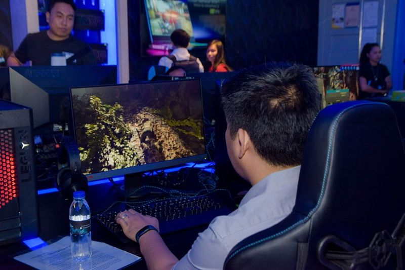 Let the games begin. A guest tries out the Legion device on display at the Legion concept store at SM City Cebu Cyberzone. (Contributed Photo)