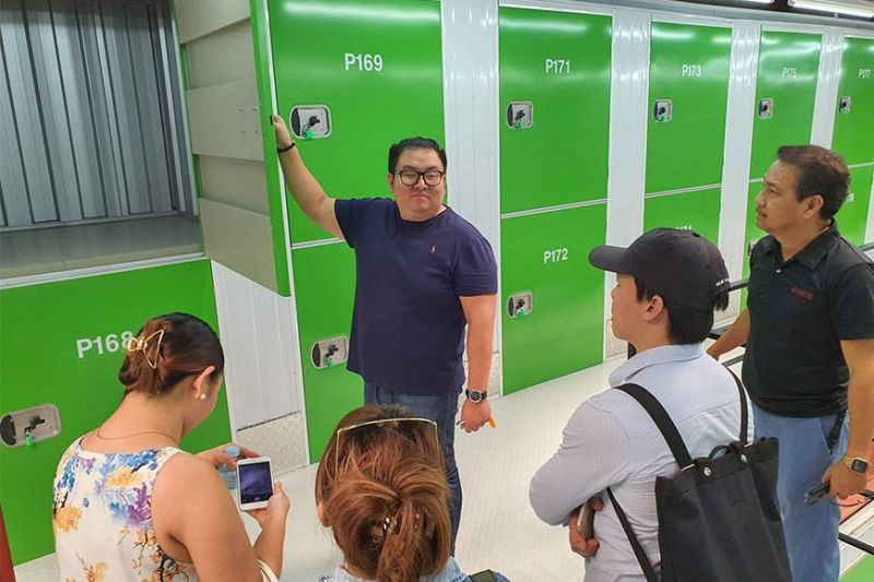 SPACE. Chase Cokaliong, president of StorageTown Inc., shows off the spaces for lease at their storage facility on Anecito St., Barangay Cabancalan in Mandaue City. Storage fees range from P999 to P45,000 per month.  (Sunstar Photo /  Arni Aclao)