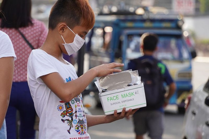 SELLING OUT FAST. A boy  sells N-88 masks at P20 each at the South Bus Terminal. There is a surge in demand for surgical masks due to the 2019-nCoV ARD scare. (Sunstar Photo / Alex Badayos)