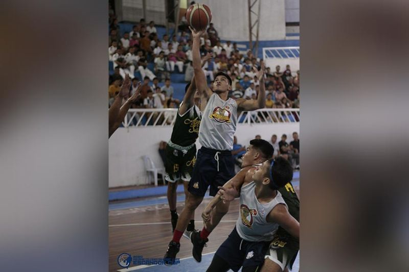 DAVAO. Mats College of Technology Navigators player Clyve Gloria shoots against Agro-Industrial Foundation College of the Philippines Sailors defender in a Philippine Collegiate Champions' League Escandor Cup Mindanao Finals game held Monday evening, February 3, at Almendras Gym Davao City Recreation Center. (Photo from Escandor Cup Facebook page)
