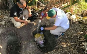 DUMAGUETE. Quarantine officers disinfect and bury three packs of processed pork at the Sibulan-Dumaguete airport that were seized from a passenger on board a Cebu Pacific flight from Manila on Tuesday (February 4, 2020). (Photo courtesy of the Bureau of Animal Industry)
