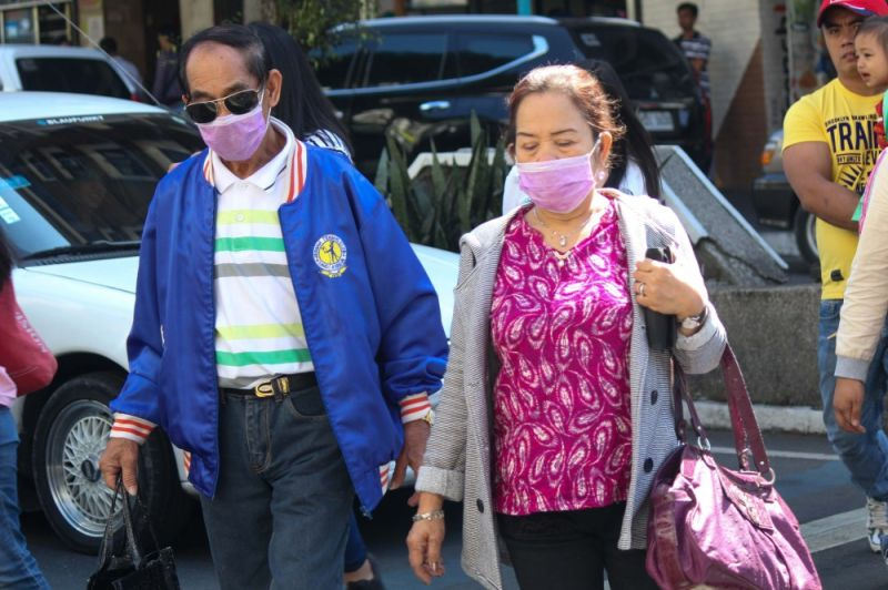BAGUIO. Elders wear face masks when roaming around the city. According to the Department of Health (DOH) those with weak immune system and the elderly are prone to being infected with the 2019 novel coronavirus, or 2019-nCoV. (Photo by Jean Nicole Cortes)