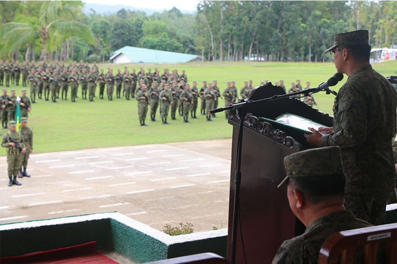 ILOILO. Major General Eric C Vinoya, the newly promoted Commander of the Army's 3ID with the officers and members of the 12th Infantry (Lick 'Em) Battalion which was formally transformed from cadre to maneuver battalion at the  Army's 3rd Infantry (Spearhead) Division based in Camp Peralta, Jamindan, Capiz on February 3, 2020. (Photo by 3IDDPAO)
