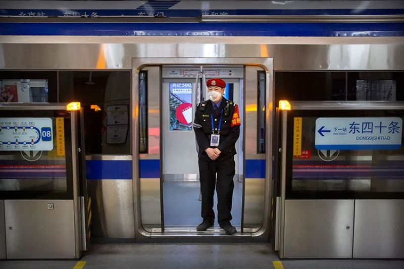CHINA. In this February 3, 2020, file photo, a security officer wearing a face mask stands on a subway train in Beijing. (AP)