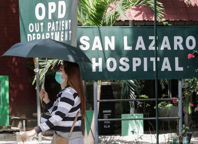 MANILA. A woman wearing a protective mask walks inside the compound of the San Lazaro Hospital where the first death from the new virus was confirmed in Manila, Philippines on Wednesday, February 5, 2020. (AP)