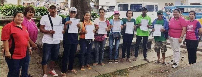 BACOLOD. Agrarian reform beneficiaries receive their certificates of land ownership award from the Department of Agrarian Reform - Negros Occidental I in Murcia town earlier this week. (Contributed photo)