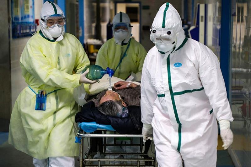 CHINA. In this Thursday, Feb. 6, 2020, photo, medical workers transfer a patient to the isolation ward for 2019-nCoV patients at a hospital in Wuhan in central China's Hubei province. The number of confirmed cases of the new virus rose again in China on Saturday, Feb. 8, 2020, as the ruling Communist Party faced anger and recriminations from the public over the death of a doctor who was threatened by police after trying to sound the alarm about the disease over a month ago. (Chinatopix via AP)