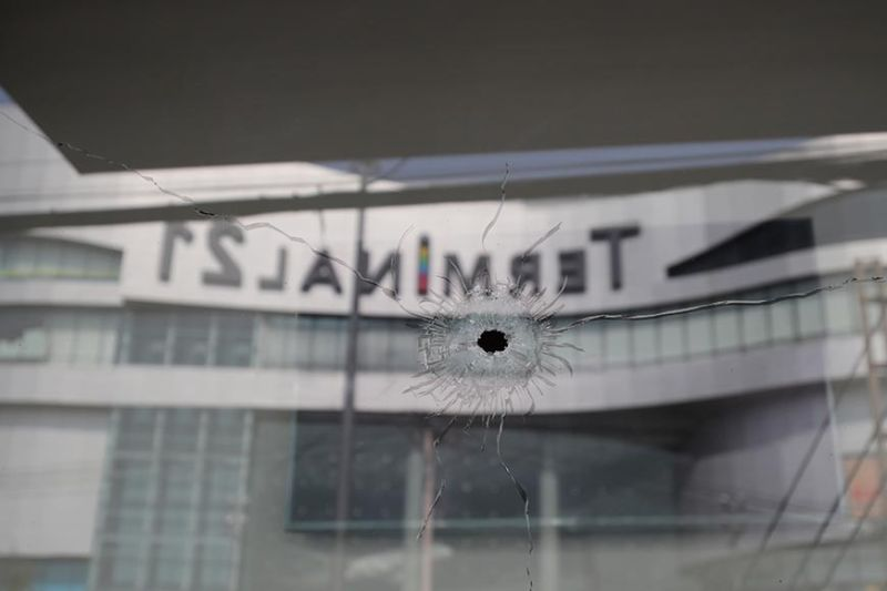 THAILAND. Bullet holes reflect the Terminal 21 Korat mall in Nakhon Ratchasima, Thailand, Sunday, Feb. 9, 2020. Thai officials say a soldier who went on a shooting rampage and killed numerous people and injured dozens of others has been shot dead inside the mall. (AP Photo)