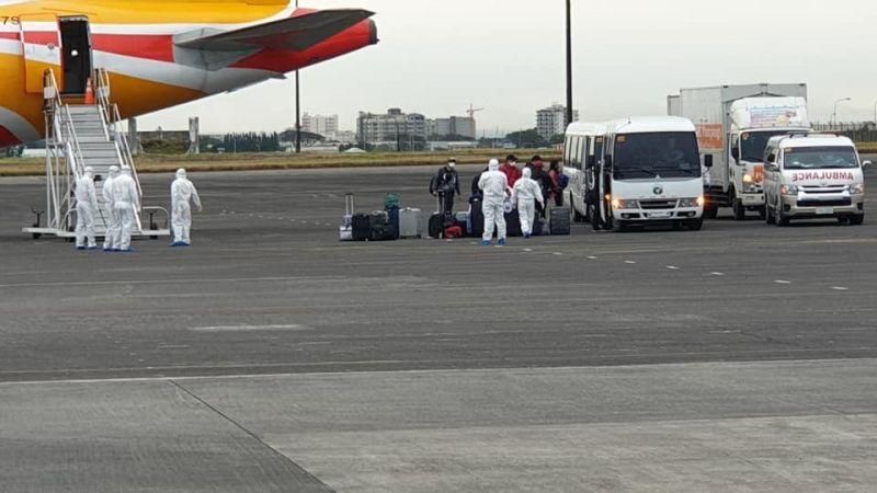 PAMPANGA. Repatriated Filipinos board a bus at Clark International Airport before heading to New Clark City Sunday morning, February 9, 2020. (Photo from DFA Undersecretary Sarah Arriola)