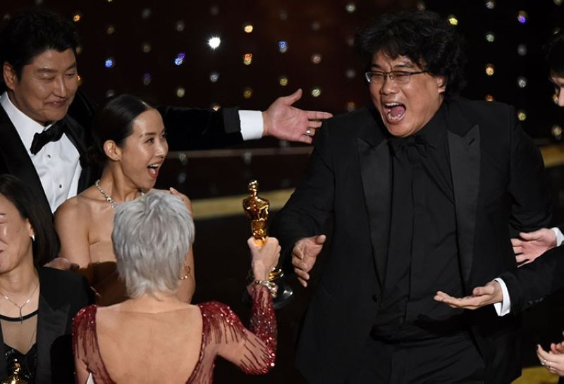 USA. Bong Joon Ho (right0 reacts as he is presented with the award for best picture for