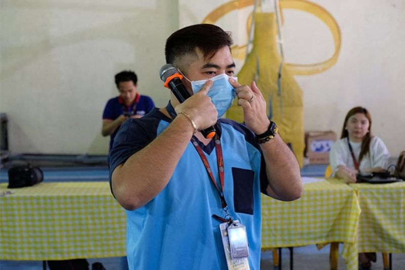PAMPANGA. Nurse Murphy Manlapaz from the Mabalacat City Health Office shows barangay health workers the proper way of wearing a face mask during a forum against the 2019 novel coronavirus. (Contributed photo)