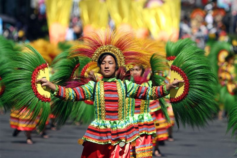 BAGUIO. Street dancers perform during last year's grand street dancing parade of the Panagbenga Festival. Parades for the annual flower festival which was moved to a later date remain dependent on DOH advisories amid threat on the 2019 novel corona virus. (SSB file photo)