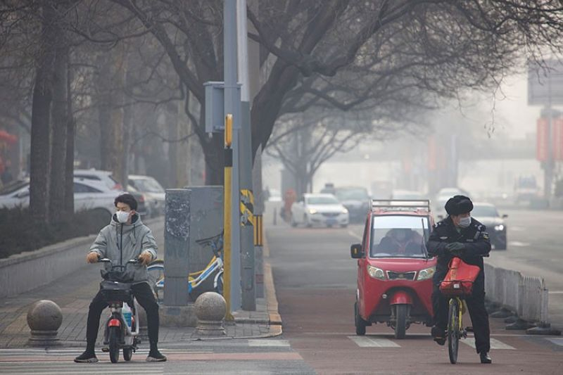 CHINA. Residents wear masks on a street of Beijing, China Tuesday, February 11, 2020. (AP)