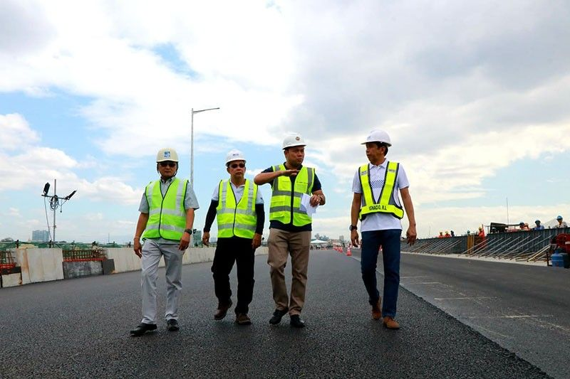 CITY OF SAN FERNANDO. DPWH Secretary Mark Villar with Raul Ignacio, NLEX COO; Nemensio Castillo, VP for Toll Way Development and Engineering NLEX; and Fernando Autor, VP for Project Management inspected on Friday the NLEX Harbor link Malabon exit which will open on February 21.(Photo by Chris Navarro)
