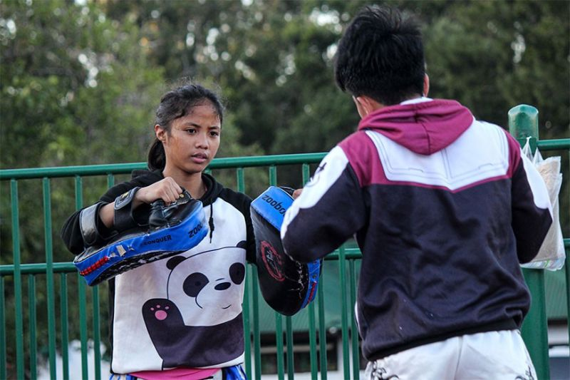 BAGUIO. Aira Nicole Mendoza, grade 8 student from Pines City National High School (PSNHS) trains with fellow Muay Thai athletes at the Baguio Athletic bowl in preparation for the upcoming Caraa meet on March. Mendoza will be fighting in the 42kgs category. (Photo by Jean Nicole Cortes)