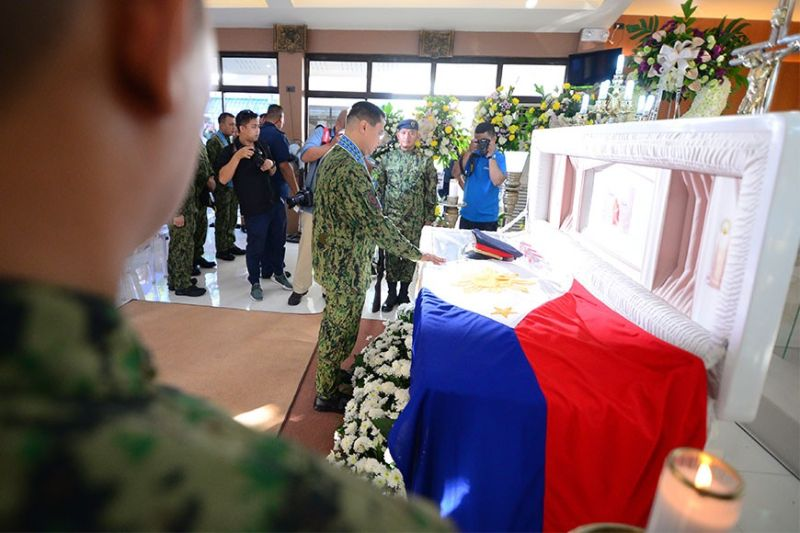 Philippine National Police (PNP) Chief Archie Francisco Gamboa visits the wake of slain Police Captain Efren Espanto at Chapel of Camp Martin Delgado in Iloilo City, on Saturday, February 15. (Leo Solinap)