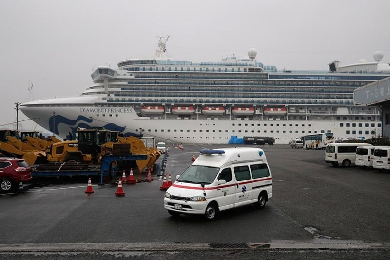 JAPAN. An ambulance leaves a port where the quarantined Diamond Princess cruise ship is docked Sunday, Feb. 16, 2020, in Yokohama, near Tokyo. The U.S. says Americans aboard the quarantined ship will be flown back home on a chartered flight Sunday, but that they will face another two-week quarantine. (AP Photo)